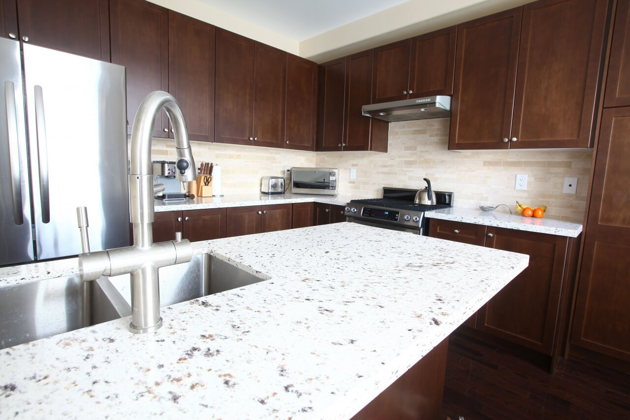 Kitchen countertops and surfaces-Wellington Kitchen & Bath Home Remodeling Solutions-We do kitchen & bath remodeling, home renovations, custom lighting, custom cabinet installation, cabinet refacing and refinishing, outdoor kitchens, commercial kitchen, countertops, and more